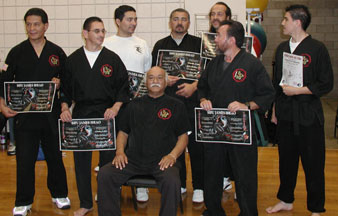 Chris with his teacher, James Ibrao and other black belts